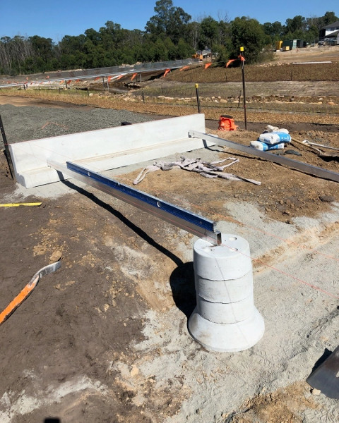 Precast abutment and piers placed onto a compacted base.
